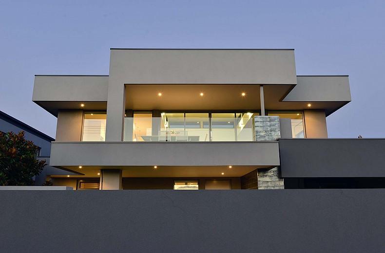The simple crisp lines of the upper floor.