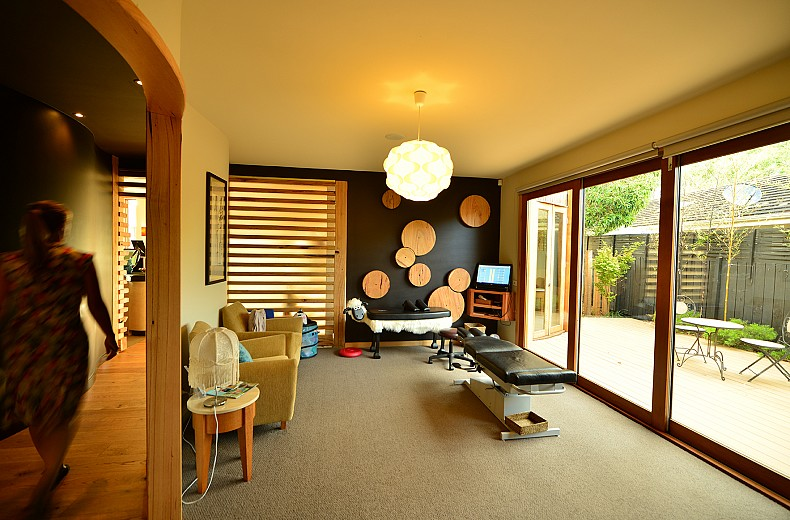 One of the treatment rooms off the curved hallway, opens onto an outdoor relaxation area.