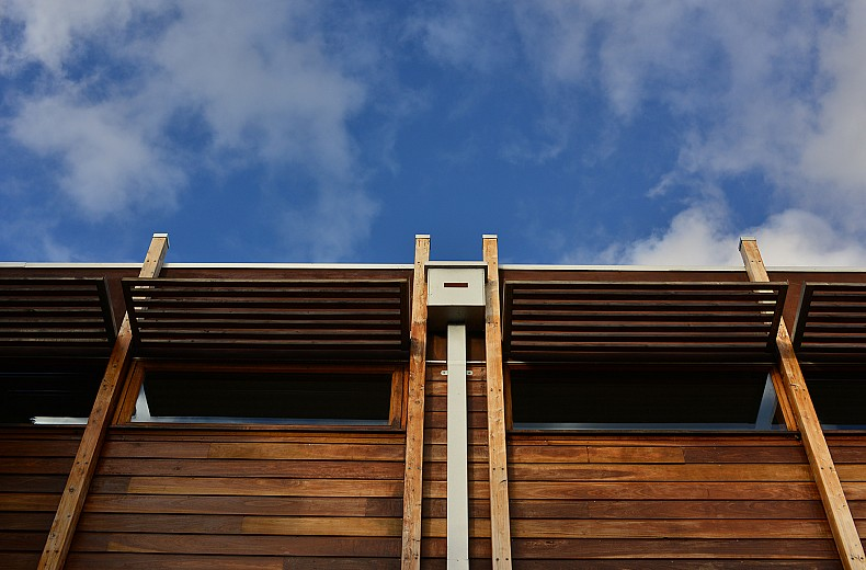 Timber detailing along the sides and rear of the upper storey.